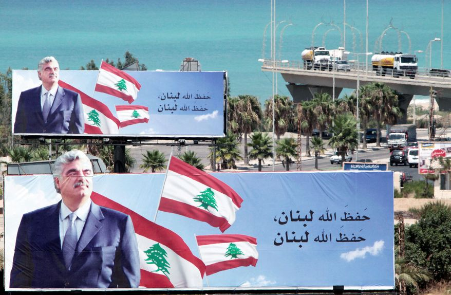 "Billboards honoring Lebanese former Prime Minister Rafik Hariri are situated on a highway in the southern port city of Sidon. The special court investigating his slaying unsealed an indictment Wednesday against four members of Hezbollah, but it contained no direct evidence against them. The Arabic reads: ""May God protect Lebanon."""