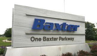 **FILE** This photo from July 2009 shows the sign outside Baxter International Inc. in Deerfield, Ill. (Associated Press/Arlington Heights Daily Herald)
