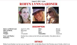 A missing-person flier released by the FBI requests information on Robyn Gardner, a suburban Washington woman who went missing after she flew to Aruba with traveling companion Gary V. Giordano on Sunday, July 31, 2011. He reported her missing two days later, saying she had disappeared while the two were snorkeling. (AP Photo/FBI)