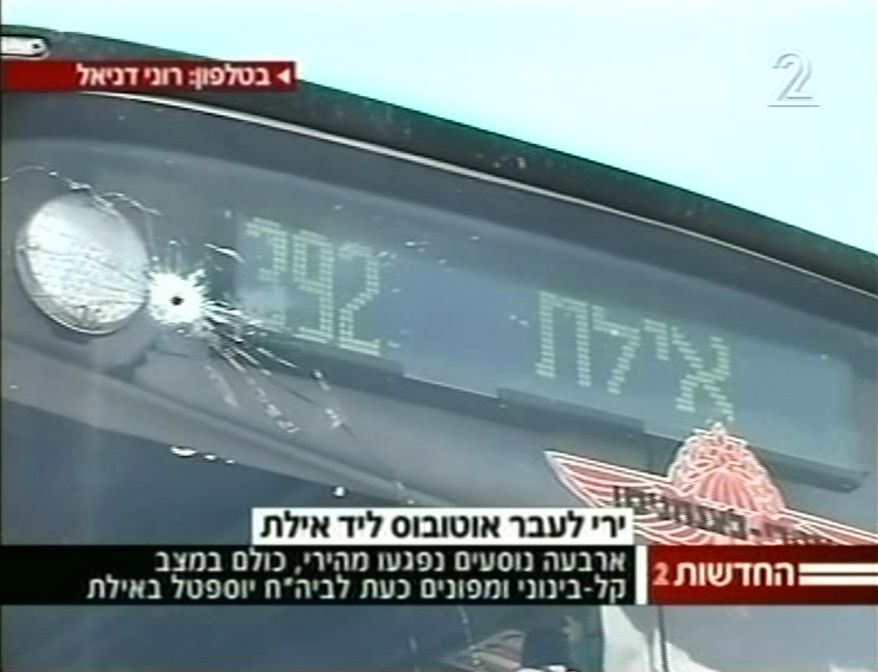 A passenger bus was damaged when assailants carried out three consecutive attacks in southern Israel near the Egyptian border on Thursday, Aug. 18, 2011. (AP Photo/Channel 2 TV)