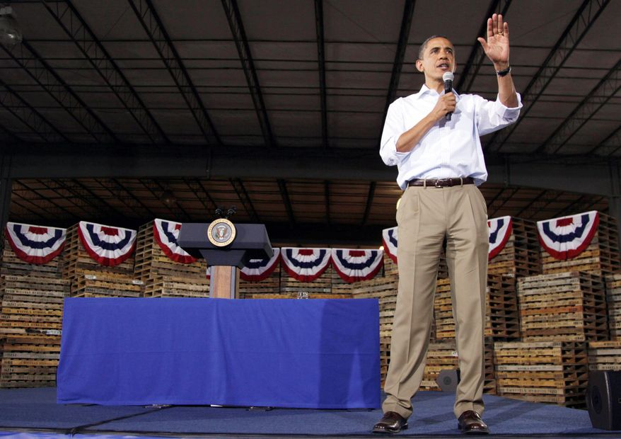 "President Obama speaks at a town-hall meeting in Atkinson, Ill., as part of his three-day economic bus tour. ""If everybody took an attitude of shared sacrifice, we could solve our deficit and debt problem next week,"" he tells a hybrid-seed factory audience. (Associated Press)"