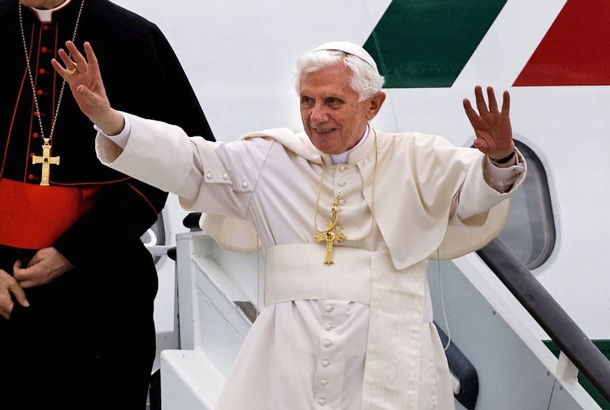 Pope Benedict XVI waves as he arrives at Madrid Barajas airport, Thursday, Aug. 18, 2011. The Pontiff arrived in the Spanish capital of Madrid for a four-day visit on the occasion of the Catholic Church's World Youth Day. (AP Photo/Emilio Morenatti)