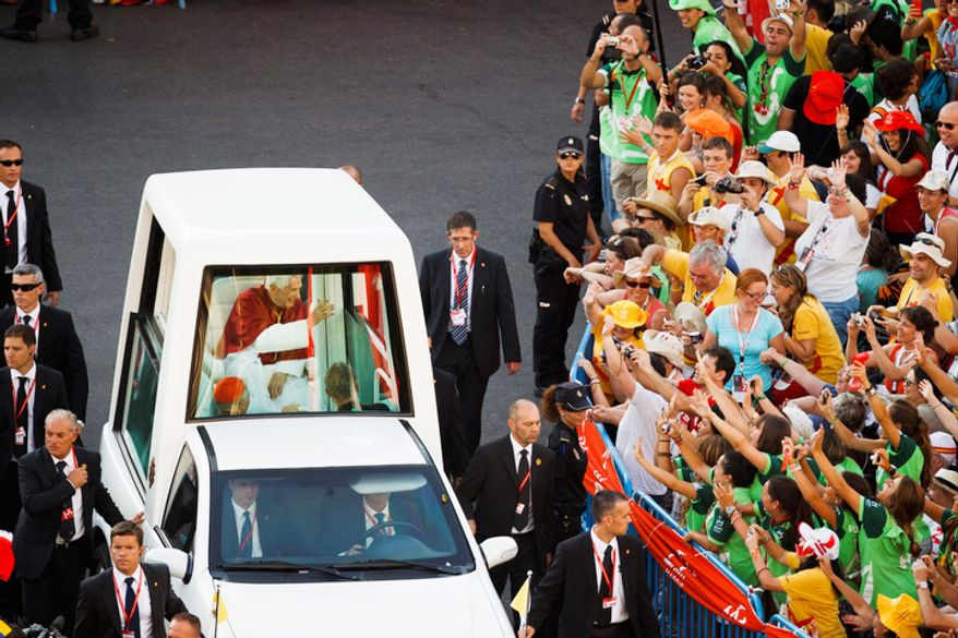 Pope Benedict XVI waves from his Popemobile as he crosses the city of Madrid on his way to Cibeles central square, Thursday Aug. 18, 2011. The Pontiff arrived in Madrid for a four-day visit on the occasion of the Catholic Church's World Youth Day. (AP Photo/Daniel Ochoa de Olza)