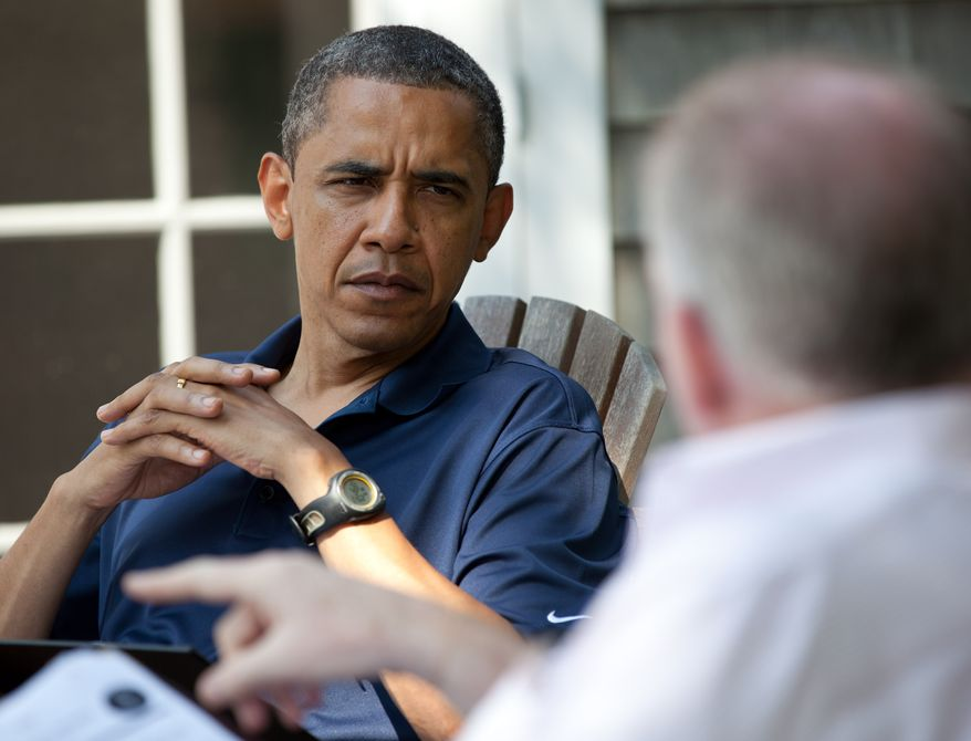 President Obama receives a briefing on Aug. 19, 2011, from Homeland Security and Counterterrorism adviser John Brennan in Martha's Vineyard, Mass. (Courtesy of the White House)