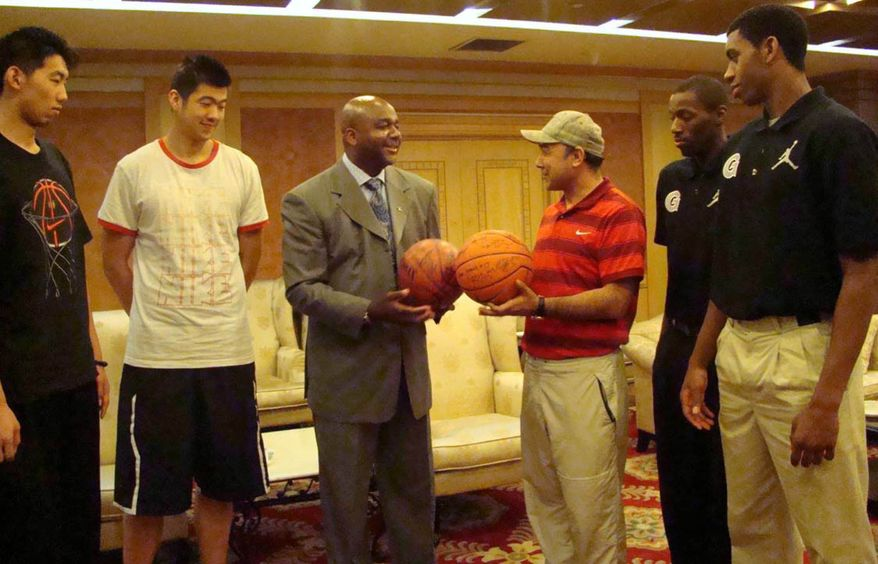 Bayi Rockets players Chen Yu and Lehei De, Georgetown University basketball coach John Thompson III, Bayi Rockets coach Adejiang along with Georgetown student-athletes Jason Clark and Hollis Thompson talk during a meeting on Friday morning in Beijing a day after the on-court brawl that occurred with ten minutes to play. (Photo by Christina Ciocca, Georgetown University)