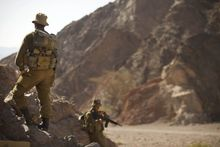 Israeli soldiers secure the area near roads leading to the sites of several attacks in the Arava desert, near the southern Israeli resort town of Eilat on Aug. 19, 2011. (Associated Press)