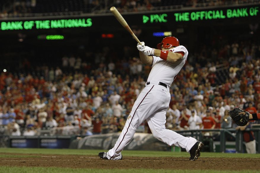 Washington Nationals Ryan Zimmerman hits a walk off grand slam against the Philadelphia Phillies on Saturday. The Nationals won 8-4. (AP Photo/Jacquelyn Martin)