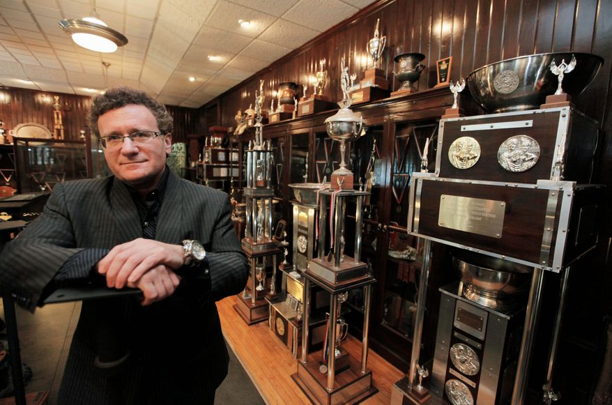 "In this Aug. 9, 2011 photo, Dr. Robert Goldman, one of the co-founders of the American Academy of Anti-Aging Medicine, is photographed in his trophy room in Chicago with hardware from 20 Guinness World Records for strength and endurance. ""People should be healthy and strong well into 100 to 120 years of age,"" Goldman says in a biographical video. ""That's what's really exciting - to live in a time period when the impossible is truly possible."" (AP Photo/M. Spencer Green)"