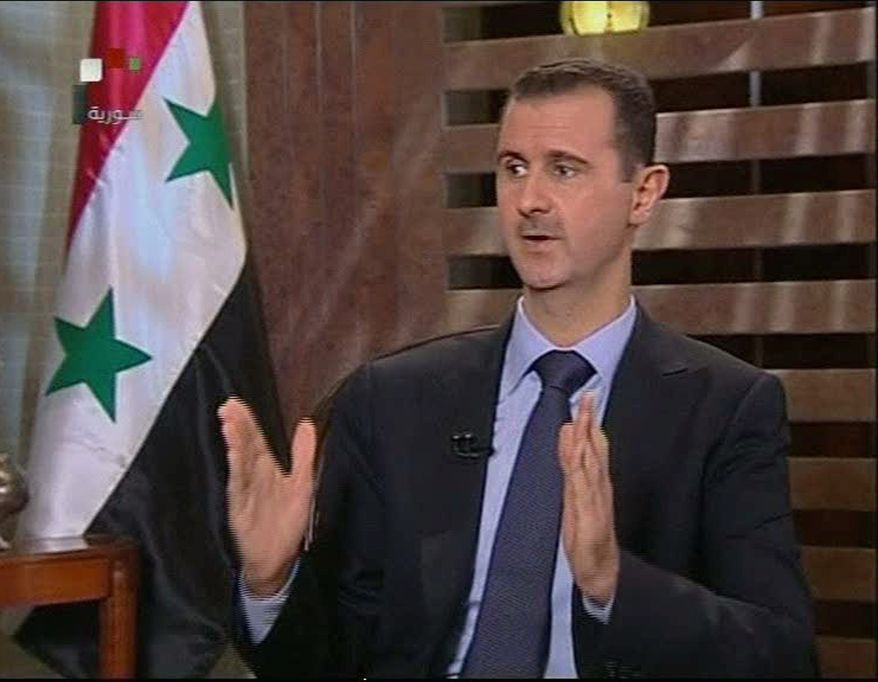 """In this image from a Syrian state television interview broadcast Sunday Aug 21 2011, President Bashar Assad says his security forces are making gains against a 5-month-old uprising and says his government is in no danger of falling. He repeated plans to introduce reforms to Syria, one of the most authoritarian states in the Middle East. He said a committee to study reforms would need at least six months to work. He said the situation in Syria """"may seem dangerous ... but in fact we are able to deal with it."""" (AP Photo/ Syrian state tv via APTN)"""