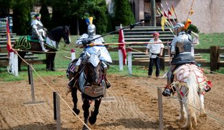 Roy Cox (right) and the Free Lancers jousting team from Nashville, Tenn., rehearse Sunday for the Maryland Renaissance Festival, which starts Saturday in Crownsville. (Pratik Shah/The Washington Times)