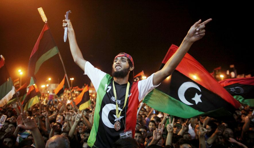 LIBERATING LIBYA: Libyans in the rebel-held town of Benghazi, Libya, celebrate the capture in Tripoli of Col. Moammar Gadhafi's son and one-time heir apparent, Seif al-Islam Gadhafi. The Hague-based International Criminal court wants him extradited to stand trial. (Associated Press)