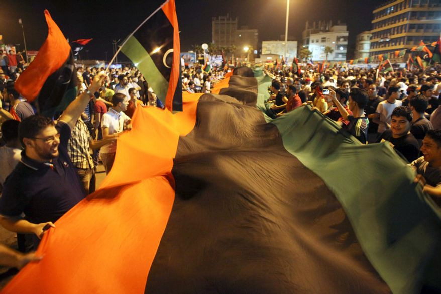 Euphoric fighters celebrated with residents of Benghazi in the city's main square, the symbolic heart of the regime. (AP Photo/Alexandre Meneghini)