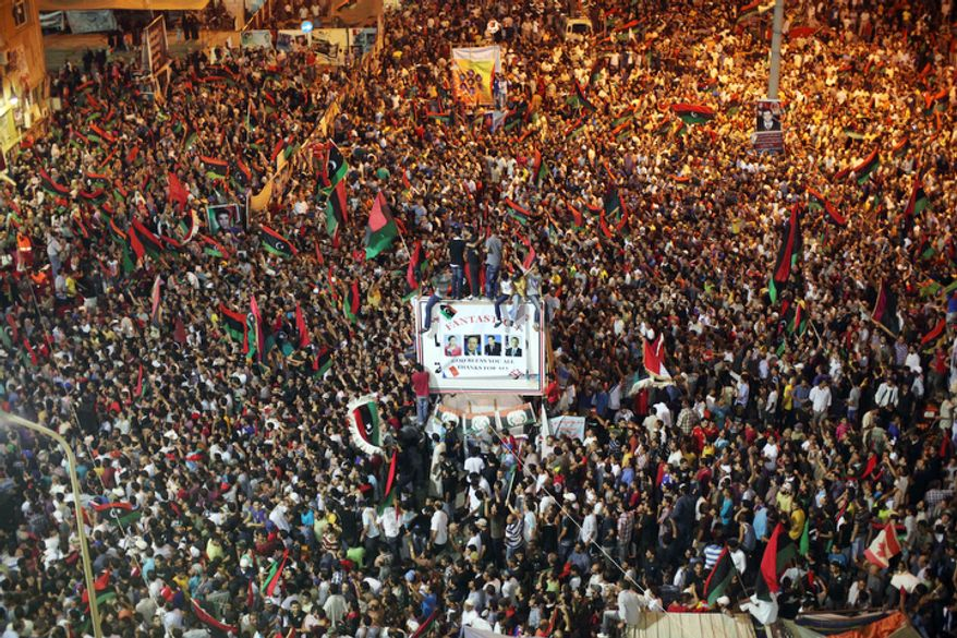 A mass of people celebrate the capture in the rebel-held town of Benghazi, Libya, early Monday, Aug. 22, 2011. (AP Photo/Alexandre Meneghini)