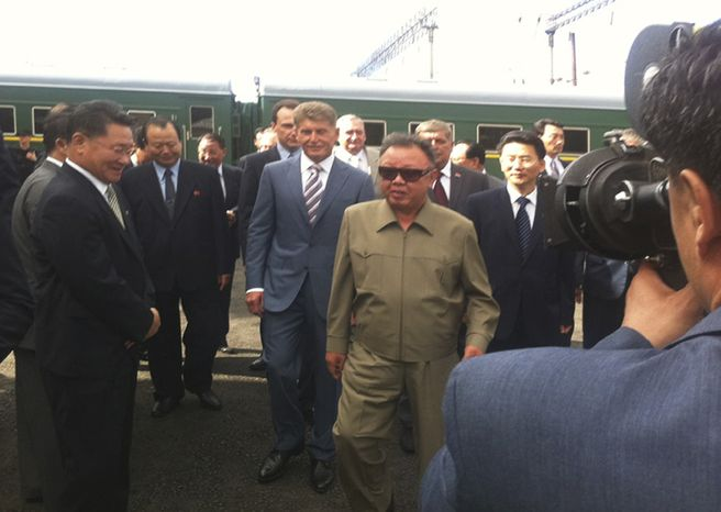 North Korean leader Kim Jong-il (center) arrives at the Bureya railway station in Russia's eastern Siberia region on Sunday, Aug. 21, 2011. Mr. Kim is on a weeklong trip to Russia, during which he will meet with Russian President Dmitry Medvedev. (AP Photo/IA Port Amur, www.portamur.ru)