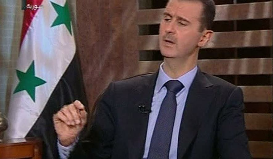 In this image from a Syrian state television interview broadcast on Sunday, Aug. 21, 2011, Syrian President Bashar Assad says that his security forces are making gains against a 5-month-old uprising and that his government is in no danger of falling. (AP Photo/Syrian state television via APTN)