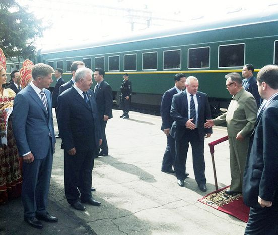 North Korean leader Kim Jong-il (second right) steps down from his armored train upon his arrival at the Bureya railway station in eastern Siberia on Sunday. Mr. Kim crossed into Russia on his armored train Saturday at the invitation of President Dmitry Medvedev.