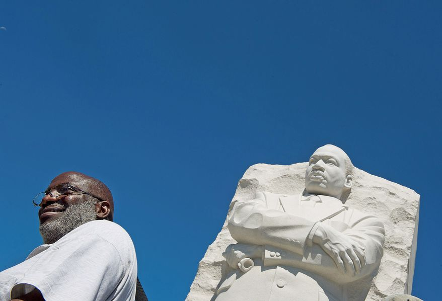 """** FILE ** """"It's amazing to be here today,"""" said Michael Berry, a Washington, D.C., native. He was first in line to see the new Martin Luther King Jr. Memorial when it opened to the public on Monday, Aug. 22, 2011. Mr. Berry said he was 13 when King was assassinated, and he remembers the riots and the impact they had on his neighborhood, his city and the nation. (Barbara L. Salisbury/The Washington Times)"""