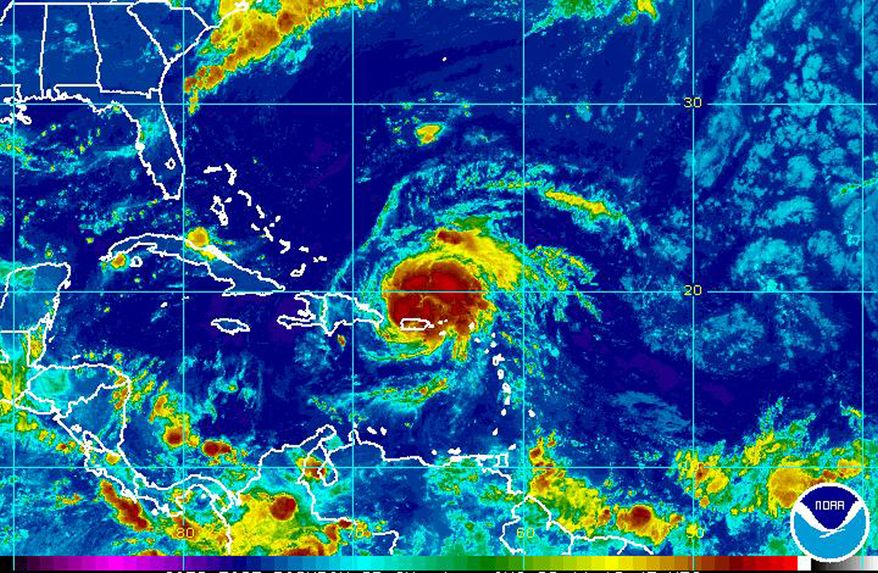 This image provided by the National Oceanic and Atmospheric Administration and taken at 6:45 a.m. EDT on Monday, Aug. 22, 2011, shows Hurricane Irene (center right) positioned approximately 55 miles west-northwest of San Juan, Puerto Rico. (AP Photo/NOAA)