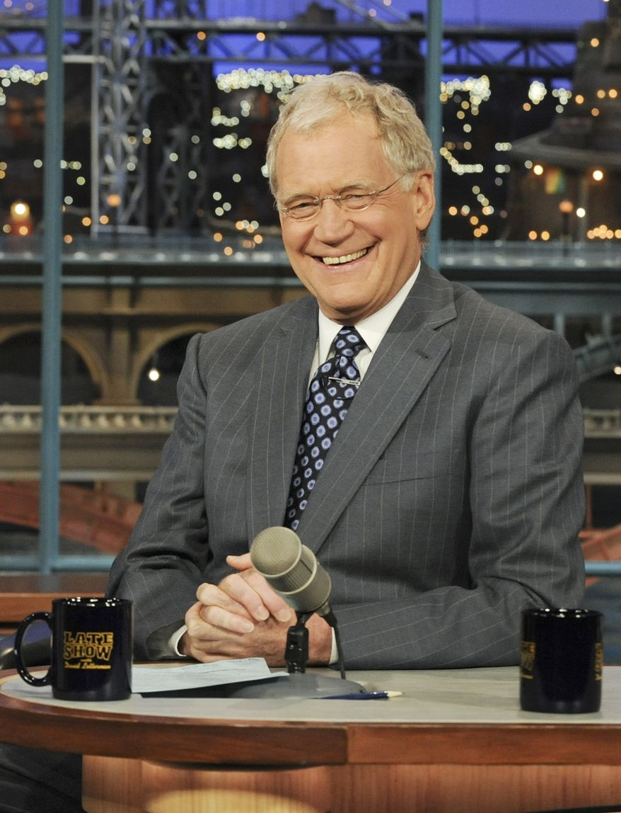 """** FILE ** In this April 21, 2010 file photo released by CBS, host David Letterman is shown on the set of the """"Late Show with David Letterman,"""" in New York. Letterman is back at """"Late Show"""" Monday, Aug. 22, 2011, after a two-week vacation, his first day at work since a threat against his life was posted on a website. Last week, a frequent contributor to a jihadist website urged Muslim followers to """"cut the tongue"""" of the late-night host because of a joke Letterman had made about al Qaeda leaders. (AP Photo/CBS, Heather Wines)"""