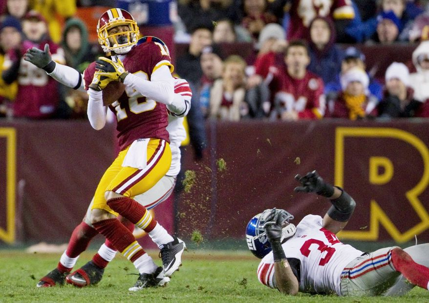 Redskins wide receiver Terrence Austin was promoted from the practice squad to the active roster late last season and finished the year with three catches, including this one against the New York Giants on Jan. 2.  (Associated Press)