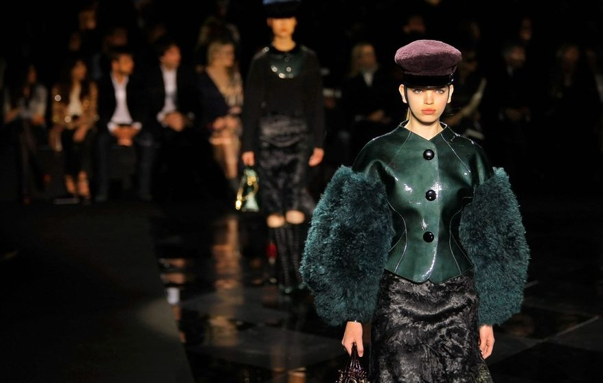 ASSOCIATED PRESS PHOTOGRAPHS A model wears a creation by American fashion designer Marc Jacobs (lbelow) for Louis Vuitton's fall-winter, ready-to-wear collection during Paris Fashion Week in March.