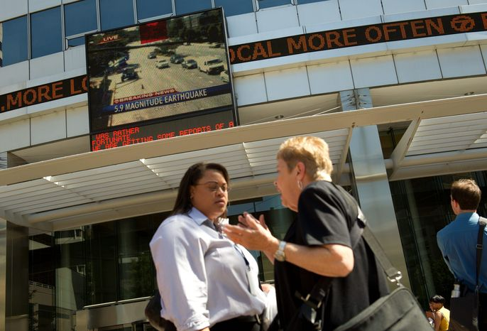"""ROD LAMKEY JR. / THE WASHINGTON TIMES  Tuesday's 5.8 magnitude earthquake sent office workers across the region out into the sunshine -including these women in Rosslyn -while buildings were checked for damage. """"It's an extraordinary and unusual situation,"""" CNN anchor Wolf Bli"""
