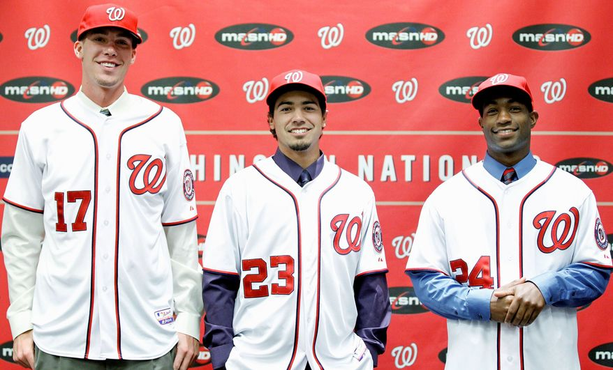 Draft picks Alex Meyer (17), third baseman Anthony Rendon (23) and outfielder Brian Goodwin (24) met members of the media before Tuesday night's game against Arizona. All three, selected year, are clients of agent Scott Boras. (Associated Press)