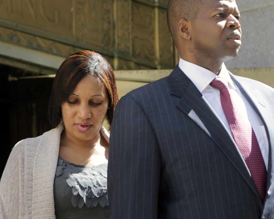 Nafissatou Diallo, the hotel housekeeper who has accused Dominique Strauss-Kahn, former head of the International Monetary Fund, of sexually assaulting her, leaves a state office building in New York with her lawyer, Kenneth Thompson, after meeting with prosecutors on Monday, Aug. 22, 2011. (AP Photo/Seth Wenig)