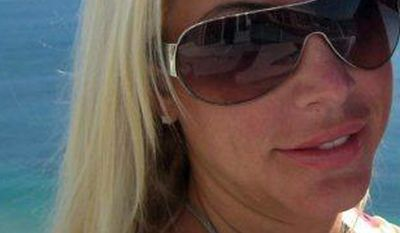 This undated handout photo, released by the Natalee Holloway Resource Center on Aug. 9, 2011, shows Robyn Gardner, 35, of Frederick, Maryland. The prosecutor's office in Aruba said Gardner has gone missing in the Caribbean island after she went snorkeling with travel partner Gary V. Giordano, 50, who was later detained by the police and is being investigated on suspicion of involvement in her disappearance. (AP Photo/Natalee Holloway Resource Center)