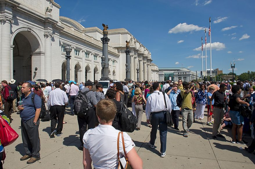 Crowds of people wait outside of Union Station on Tuesday. Inside, the quake sent screaming patrons and tourists rushing for the exits. (Barbara L. Salisbury/The Washington Times)