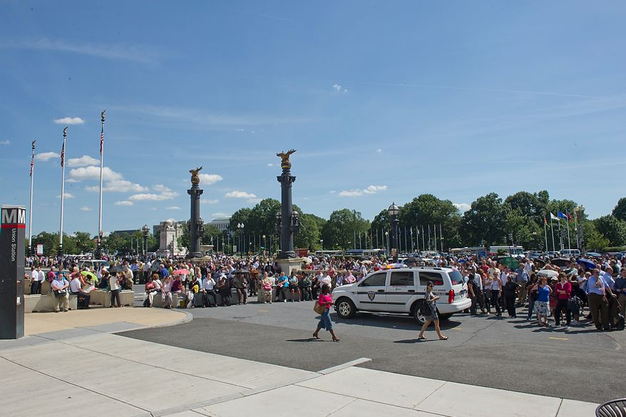 Crowds of people wait outside of Union Station on Aug. 23, 2011, following a 5.8-magnitude earthquake that hit the east coast of the United States. The quake had an epicenter of Mineral, Va., east of Charlottesville, but could be felt along much of the Eastern seaboard, including D.C. All buildings in downtown D.C. were evacuated. (Barbara L. Salisbury/The Washington Times)