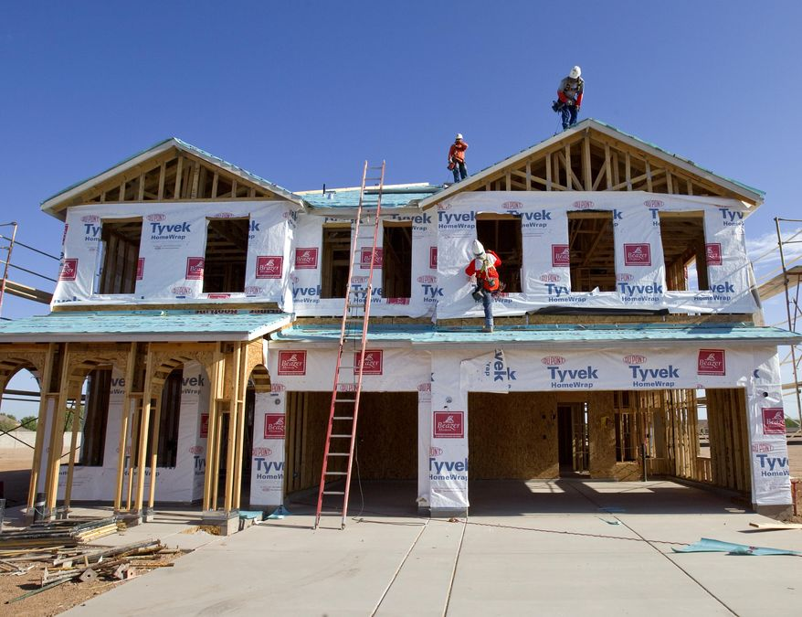 Builders frame a new home on Monday, Aug. 22, 2011, in Queen Creek, Ariz. New-home sales this year are on track to finish as the worst on records dating back a half-century. (AP Photo/Matt York)