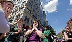 Office workers gather on the sidewalk in downtown Washington on Aug. 23, 2011, moments after a 5.9 magnitude tremor shook the nation's capitol. The earthquake centered northwest of Richmond, Va., shook much of Washington, D.C., and was felt as far north as Rhode Island and New York City. (Associated Press)