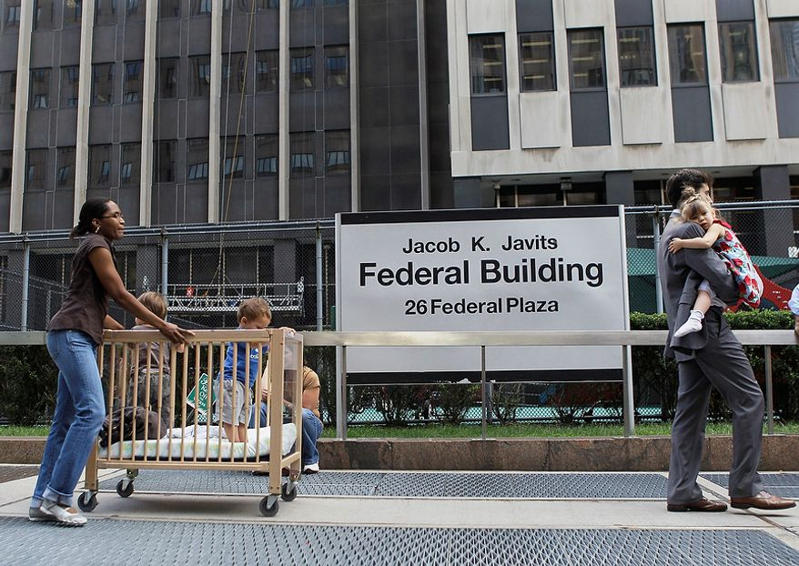 Children are evacuated from the Jacob K. Javits Federal building in New York on Tuesday, Aug. 23, 2011 after an earthquake centered northwest of Richmond, Va. was felt. (AP Photo/Mary Altaffer)