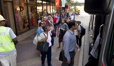 People board a bus outside of the Rosslyn Metro Station in Rosslyn, Va, Tuesday, August 23, 2011, after 5.9 earthquake struck at around 2pm EST, with an epicenter outside of Richmond, Va. (Rod Lamkey Jr./The Washington Times)