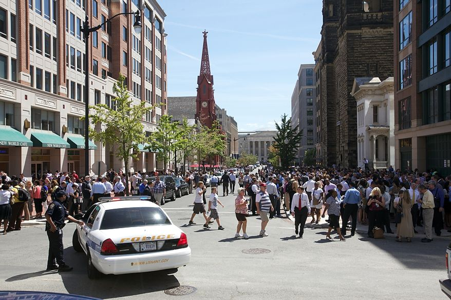 Office workers flood District streets in Chinatown in Northwest after a 5.9 earthquake in Virginia is felt in Washington, D.C., Tuesday, August 23, 2011. (Andrew Harnik / The Washington Times)