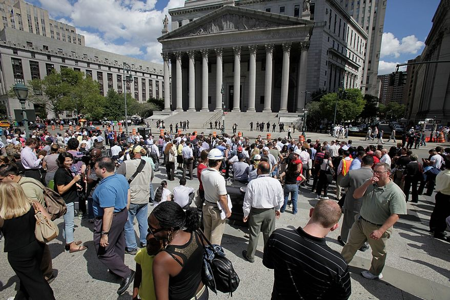 People stand in Foley Square in New York after being evacuated from the Federal and State buildings that surround it Tuesday, Aug. 23, 2011. The 5.9 magnitude earthquake centered northwest of Richmond, Va., shook much of Washington, D.C., and was felt as far north as Rhode Island and New York City. (AP Photo/Richard Drew)
