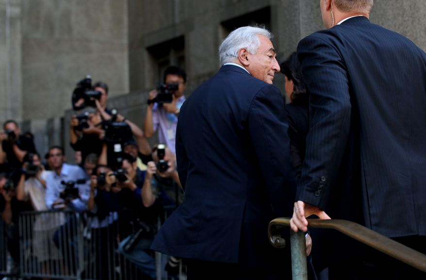 Dominique Strauss-Kahn enters the Criminal Courts Building in New York on Aug. 23, 2011. (Associated Press)