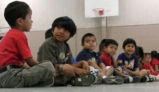 ** FILE ** Students sit in the gym at Crossville Elementary School in Crossville, Ala., on Wednesday, Aug. 17, 2011. (AP Photo/Jay Reeves)