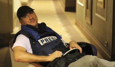 Associated Press photographer Dario Lopez-Mills poses for a photo at the Rixos hotel in Tripoli, Libya, on Aug. 24, 2011. Lopez-Mills is among dozens of journalists that were trapped for days in the luxury hotel, kept there by government enforcers. (Associated Press)