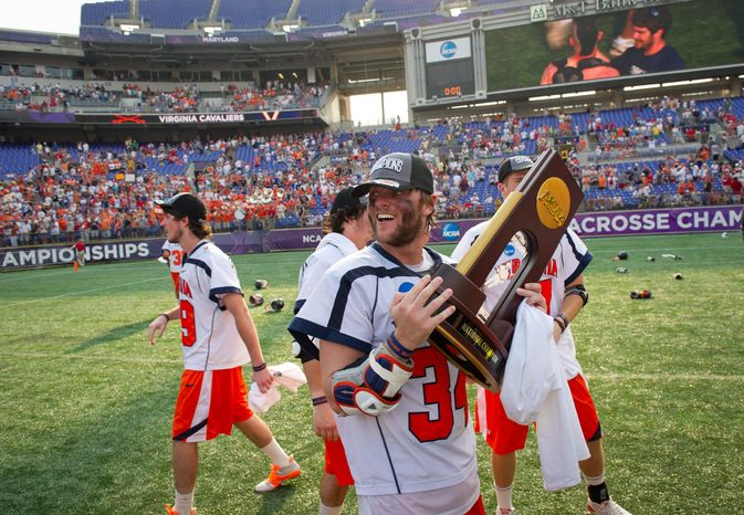 Virginia celebrated a national championship in men's lacrosse this spring, but football coach Mike London had less to cheer about, as the Cavaliers went 4-8 in his first season on the sideline. (Rod Lamkey Jr./The Washington Times)