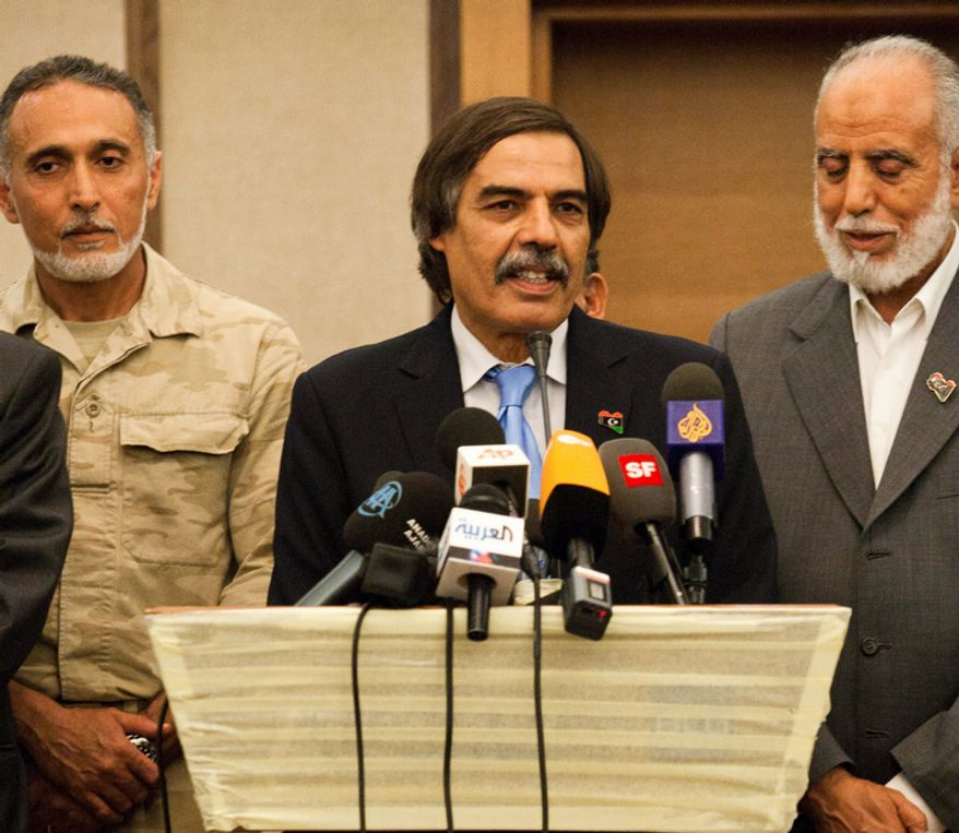 Ali Tarhouni, finance minister in the rebels' National Transitional Council,  speaks during a news conference in Tripoli, LIbya, Thursday, Aug. 25, 2011.  Ali Tarhouni, a member of Libya's rebel Cabinet says it is moving immediately to Tripoli from its eastern stronghold city of Benghazi.  (AP Photo/Giulio Petrocco)