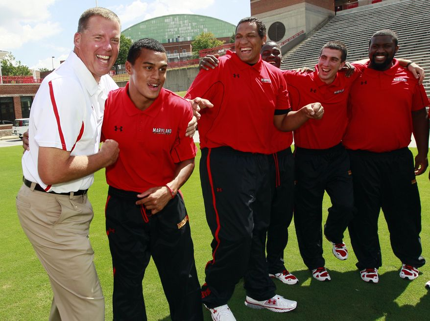 Maryland head coach Randy Edsall, left, shares a moment with defensive back Dexter McDougle, second from left, and teammates during the team's media day in College Park, Md., Tuesday, Aug. 16, 2011. The Terrapins open their season Sept. 5 at home against Miami. (AP Photo/Patrick Semansky)