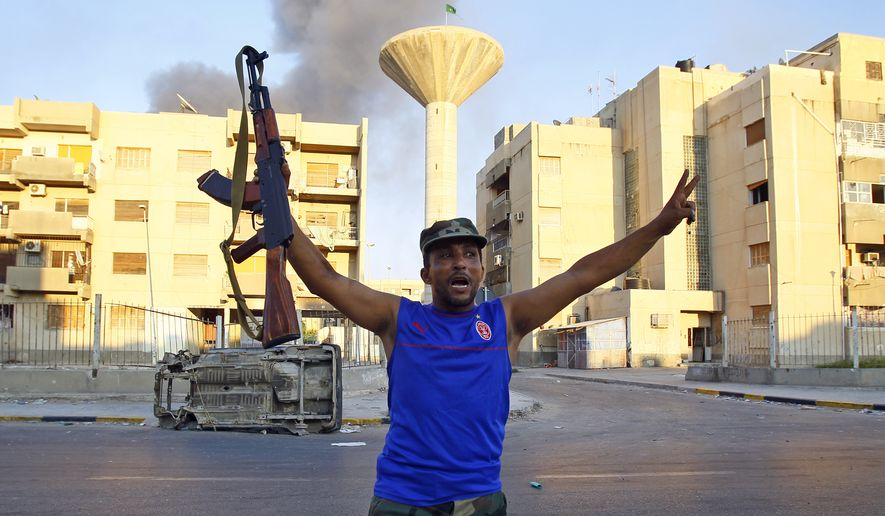 A Libyan rebel gestures in Abu Salim district in Tripoli, Libya, on Aug. 25, 2011. (Associated Press)