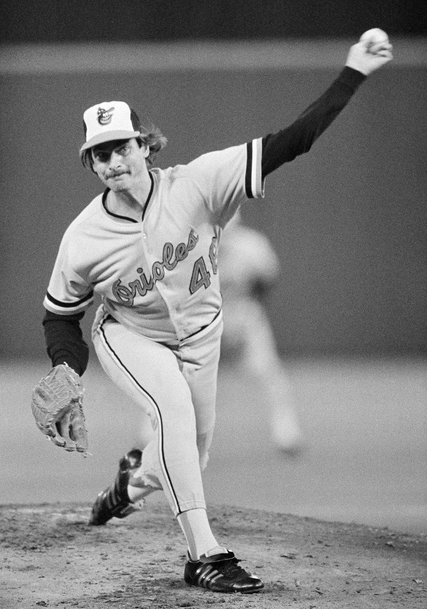 FILE - In this Oct. 14, 1983, file photo, Baltimore Orioles pitcher Mike Flanagan throws to a Philadelphia Phillies batter during baseball World Series game in Philadelphia. Former Cy Young winner Flanagan, who won 167 games over 18 seasons with Baltimore and Toronto, has died. Authorities found a body outside Flanagan's home on Wednesday afternoon, Aug. 24, 2011, and it was later determined to be the former left-handed pitcher. Flanagan was 59. The Orioles confirmed Flanagan's death Wednesday night. (AP Photo/ File)