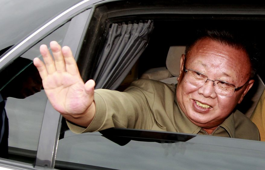 North Korean leader Kim Jong-il waves goodbye to Russian President Dmitry Medvedev (not pictured) after a meeting at a military garrison outside Ulan-Ude, Russia, on Wednesday, Aug. 24, 2011. (AP Photo/RIA Novosti, Dmitry Astakhov, Presidential Press Service)