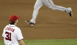 Arizona Diamondbacks Chris Young is seen circling the bases after hitting a two-run homer against Washington Nationals starting pitcher John Lannan in the sixth inning Thursday night.(AP Photo/Pablo Martinez Monsivais)