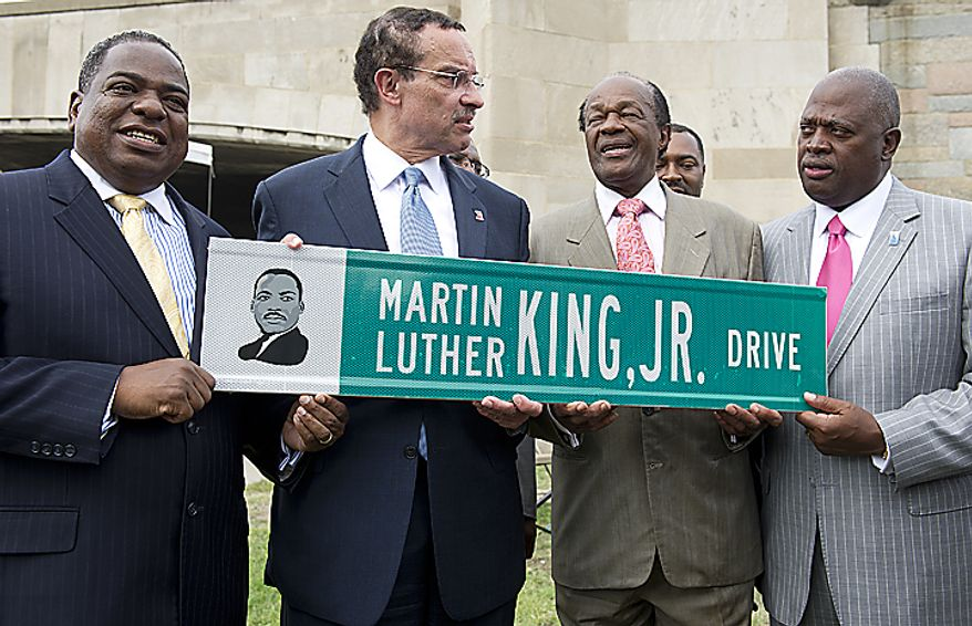 From left, Councilman Vincent Orange, D.C. Mayor Vincent Gray, Councilman Marion Barry and Harry Johnson hold one of the new Martin Luther King Jr. Drive signs at the corner of Maine Avenue and 14th Street Southwest in Washington, D.C. on Thursday, Aug. 25, 2011. The men were on sight to officially unveil the street signs that will rename this part of Maine Avenue as Martin Luther King Jr. Drive The road will continue along the Southwest Freeway and join up with the other part of Martin Luther King Jr. Drive in Southeast. (Barbara L. Salisbury/The Washington Times)