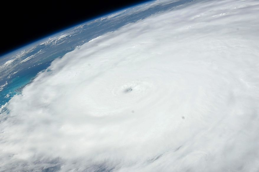 An image provided by NASA shows Hurricane Irene as photographed from onboard the International Space Station at 3:14 p.m. EDT on Aug. 24, 20ll. The image, captured with a 38 mm lens, reveals the eye of the storm at center of the frame.  (AP Photo/NASA)