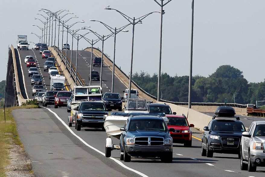 Sport utility vehicles pulling pleasure boats drive in lines of traffic headed north on the Garden State Parkway across the Great Egg Harbor Bay Inlet Bridge, Friday, Aug. 26, 2011, near Ocean City, N.J., as much of the Jersey shore evacuates inland ahead of Hurricane Irene.  (AP Photo/Mel Evans)